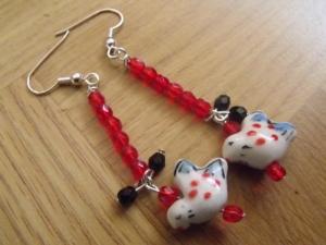 red bird dangly earrings
